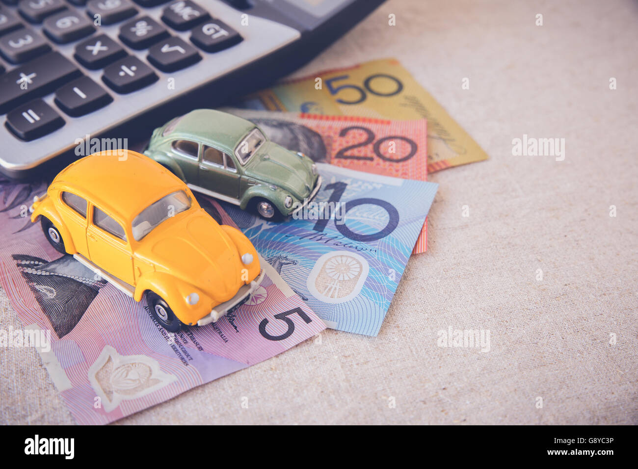 Toy cars with AUD Australian money and calculator, copy space toning ...