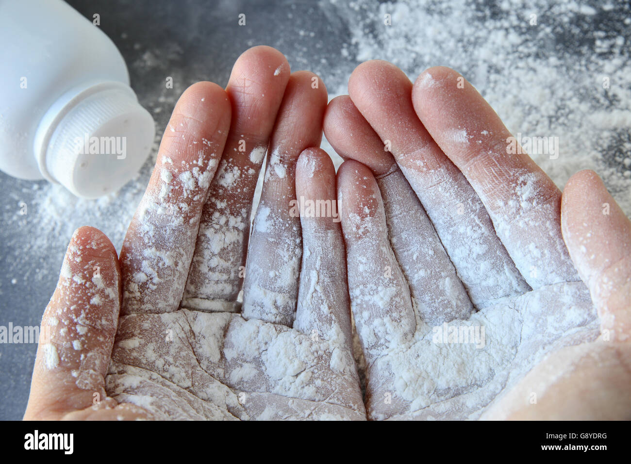 Talcum powder on two hands - Stock Image