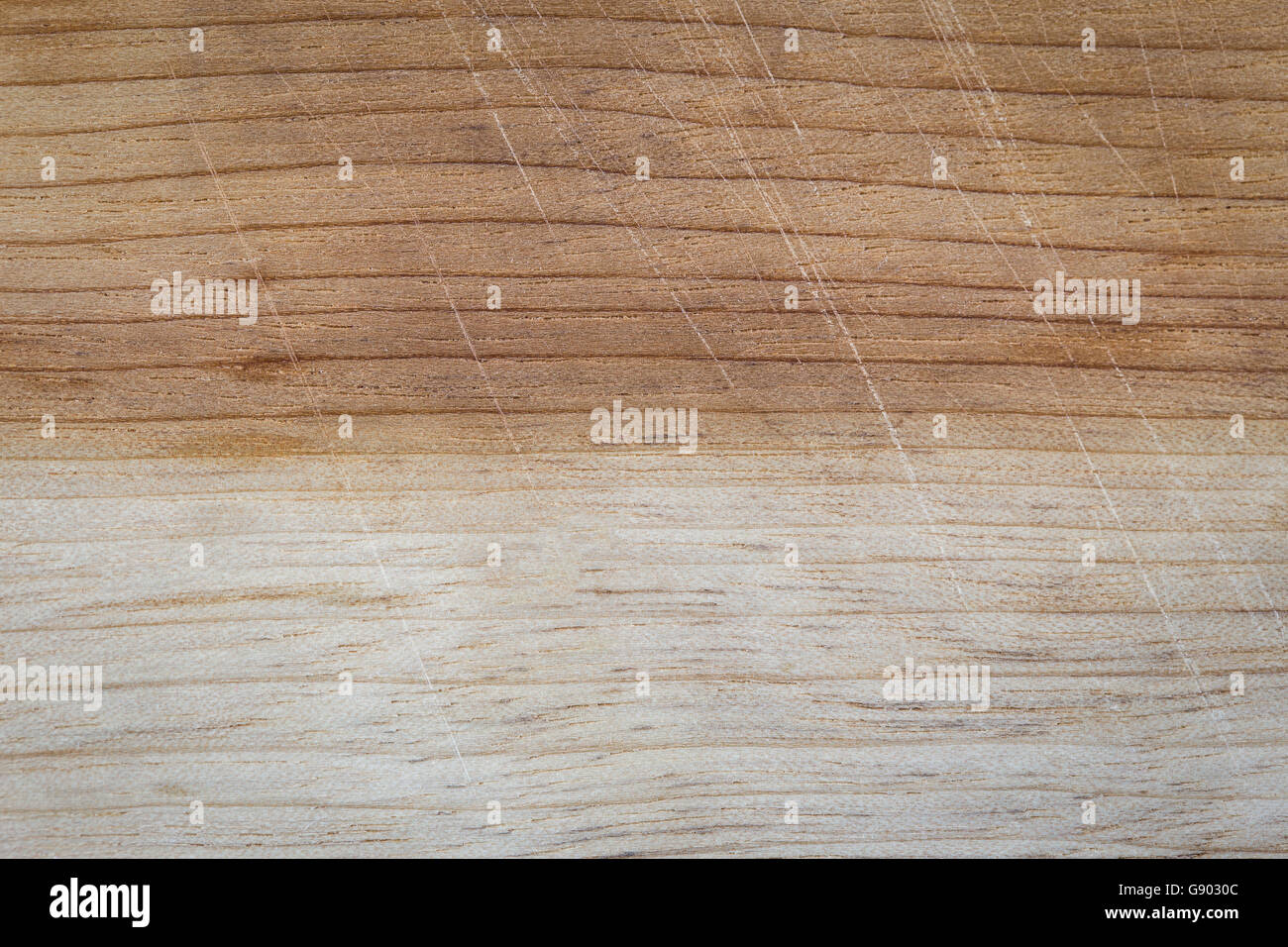 Background of used cutting board in two tones color which made from wood having scratches from knife - Stock Image