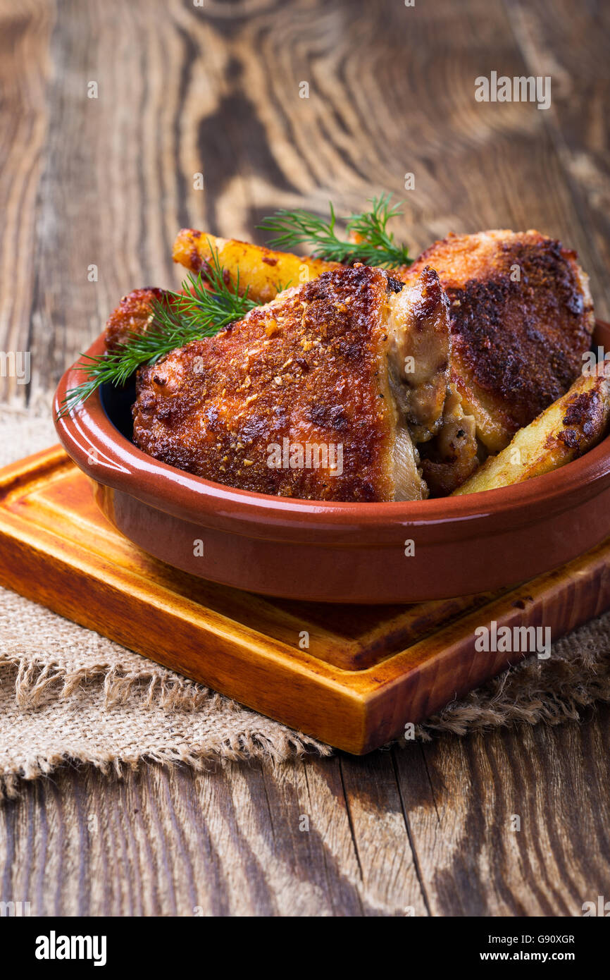 Homemade oven fried parmesan crusted chicken thighs - Stock Image