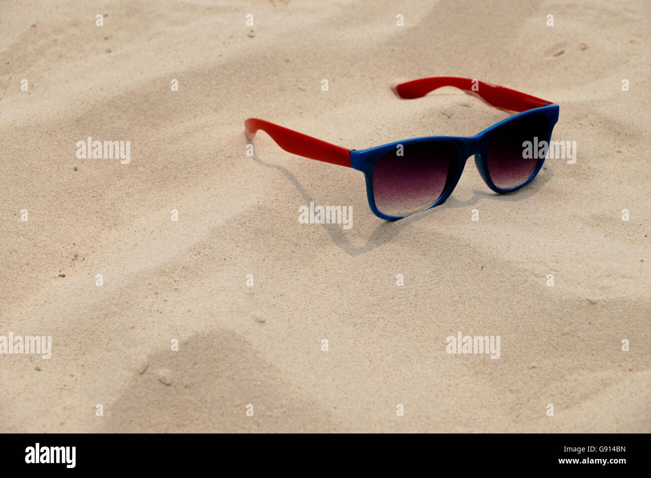 Sunglass on the Sand - Stock Image