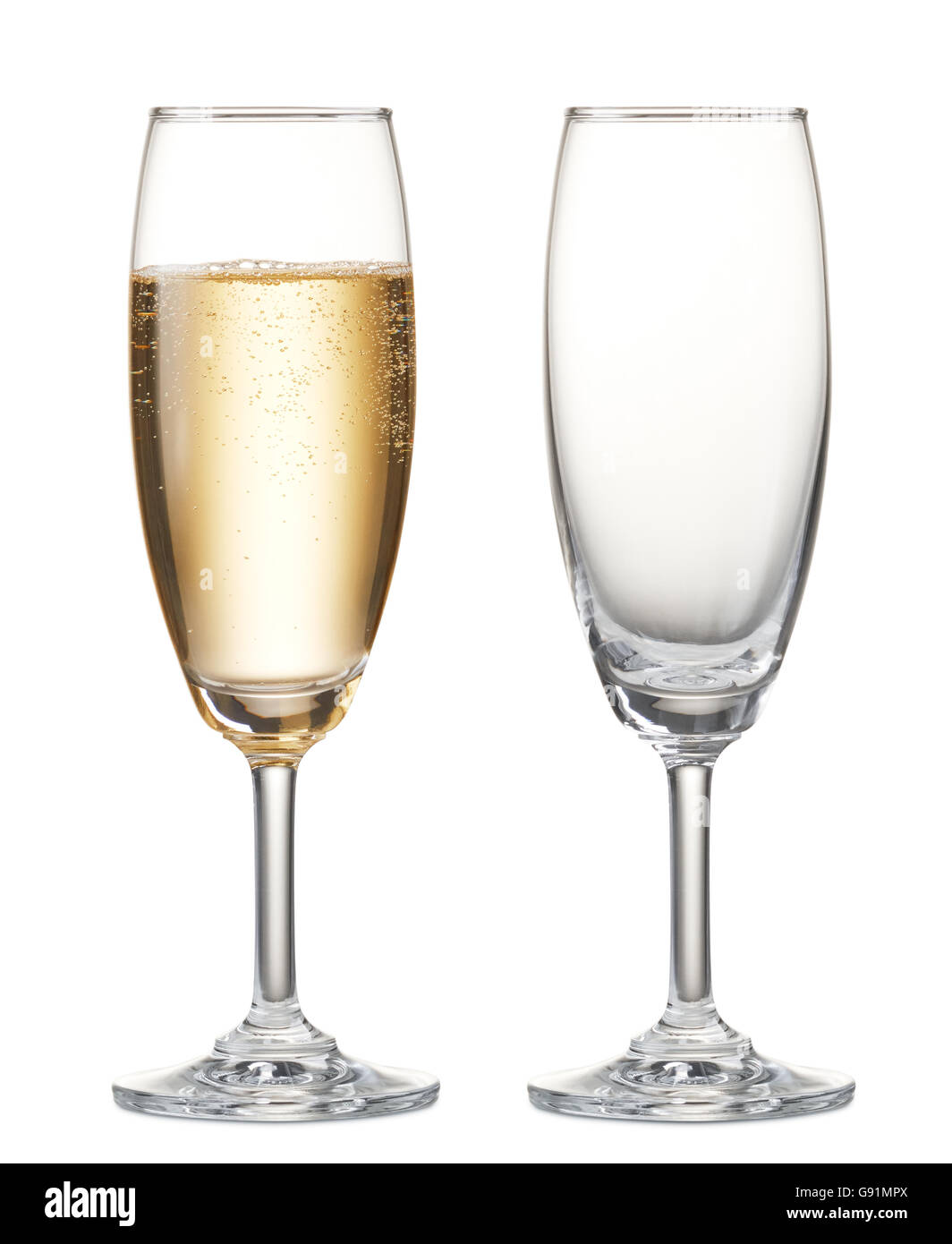 glass of champagne and empty champagne flute - Stock Image