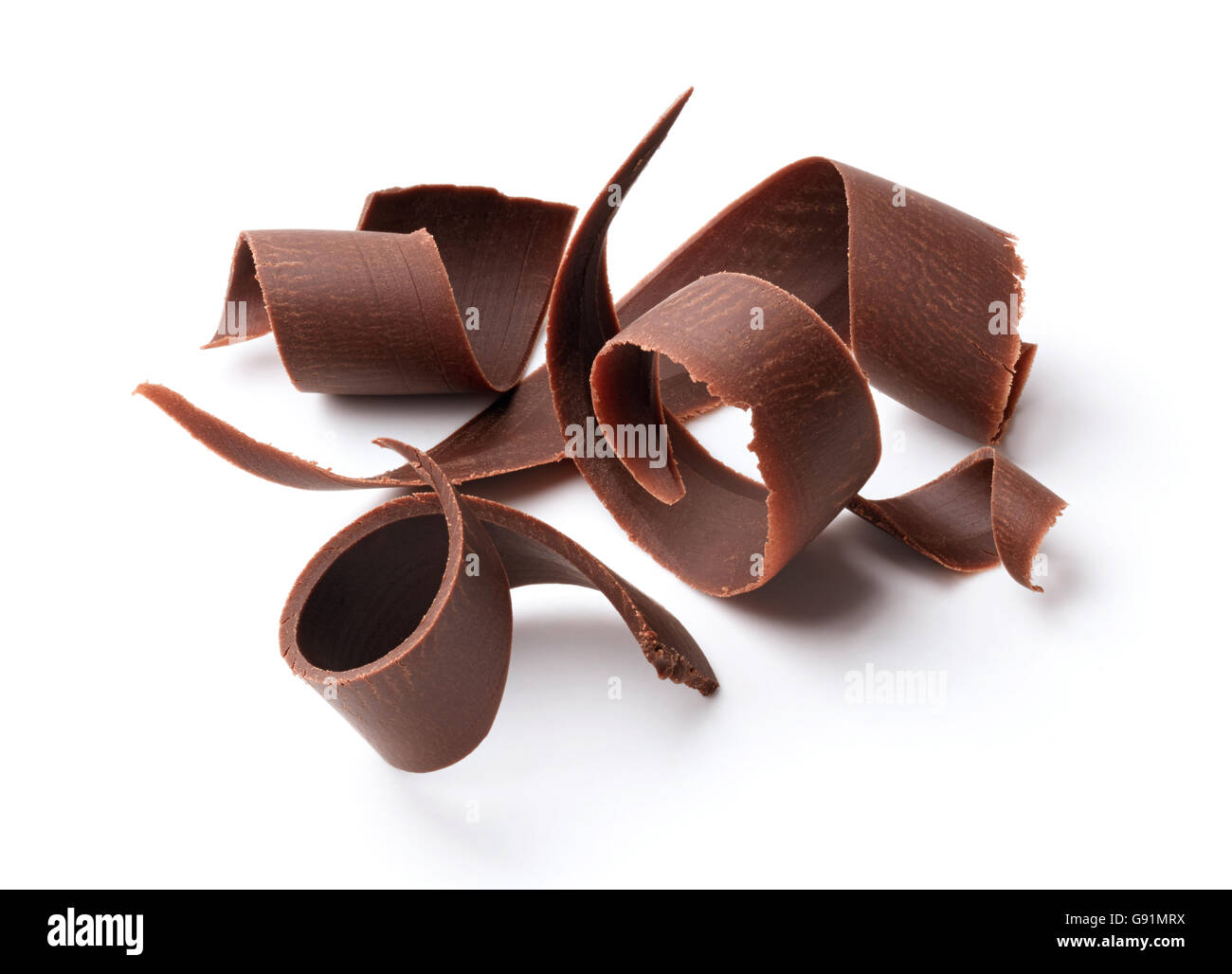 group of dark chocolate shavings isolated on white - Stock Image