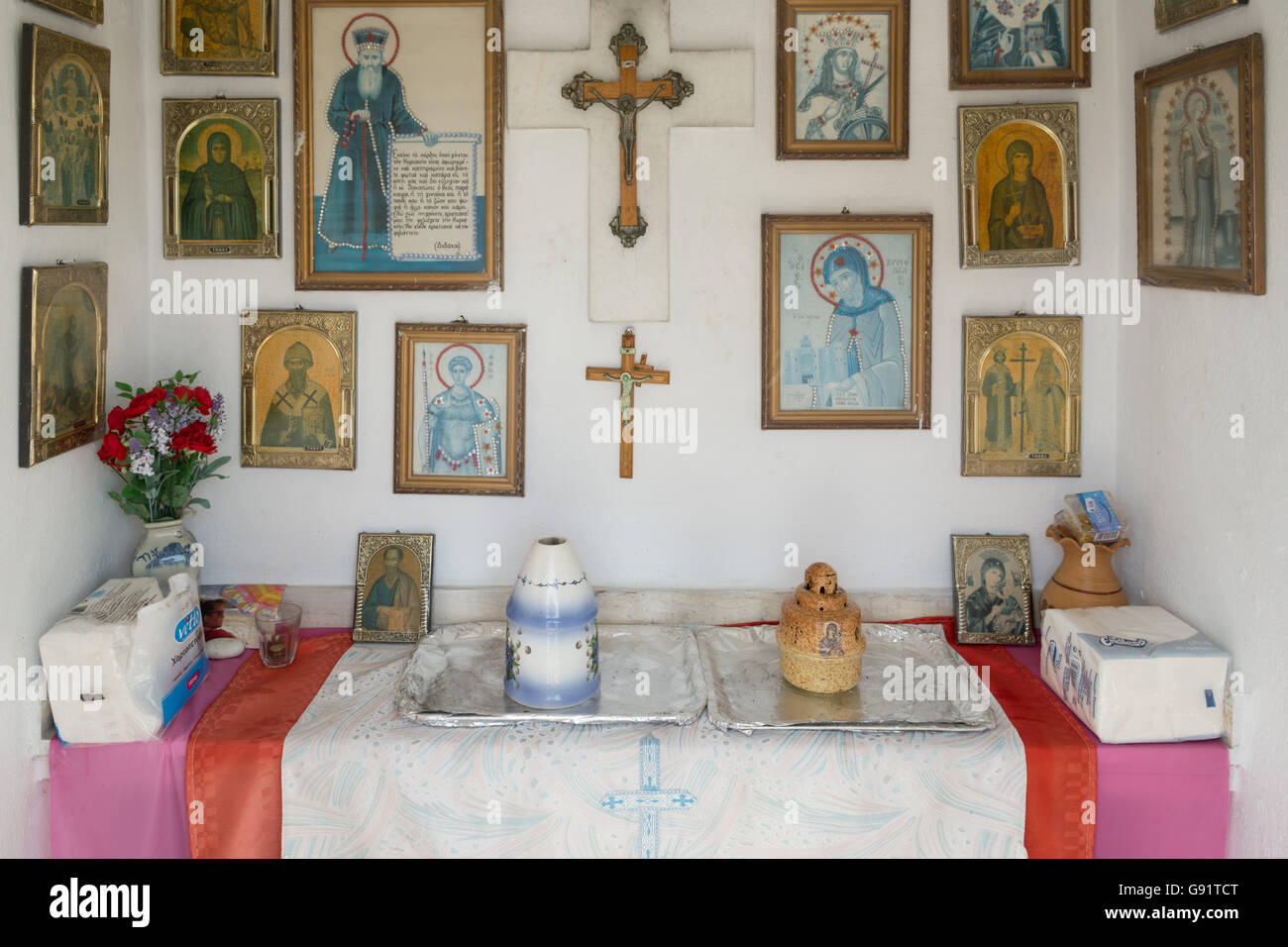 interior of Greek roadside shrine near Loggos, Paxos, Greece - the small shrines are usually to commemorate those - Stock Image
