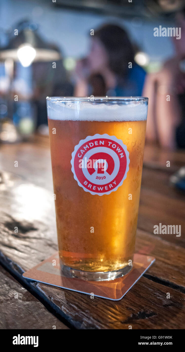Camden Town Brewery pint of pale ale on a bar in Camden Town North London Stock Photo