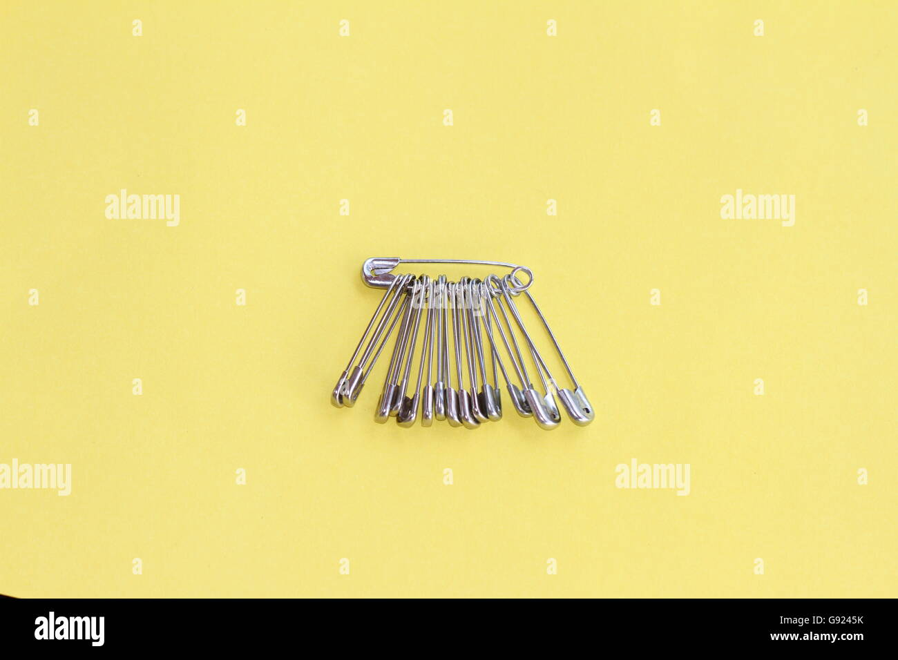 safety pins in a group a symbol of anti-hate and anti-racism after the Brexit vote - Stock Image