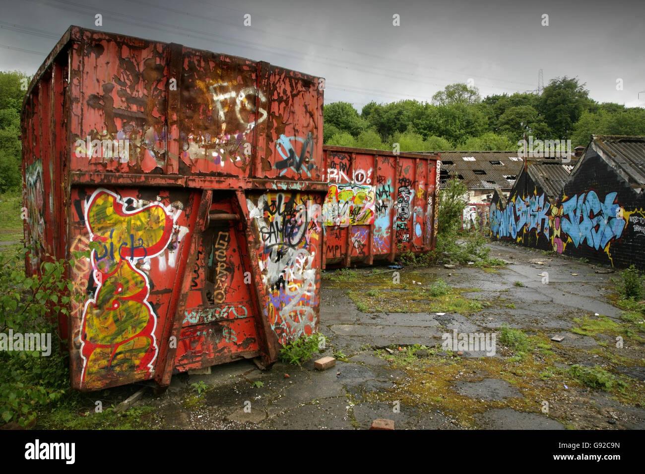 Graffiti And Vandalism On Shipping Containers At Abandoned Derelict Industrial Building