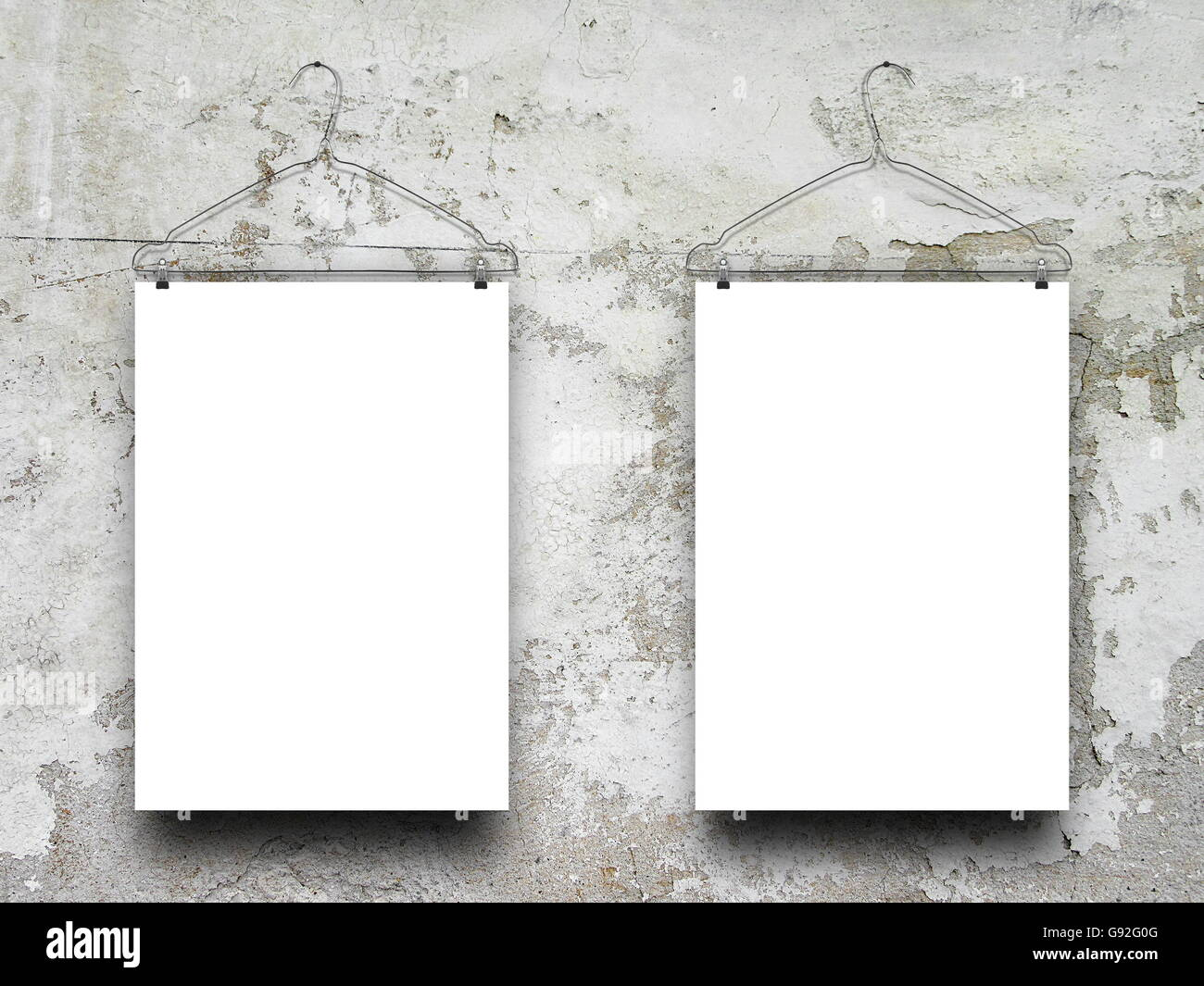 Close-up of two square blank frames hanged by clothes hanger against ...