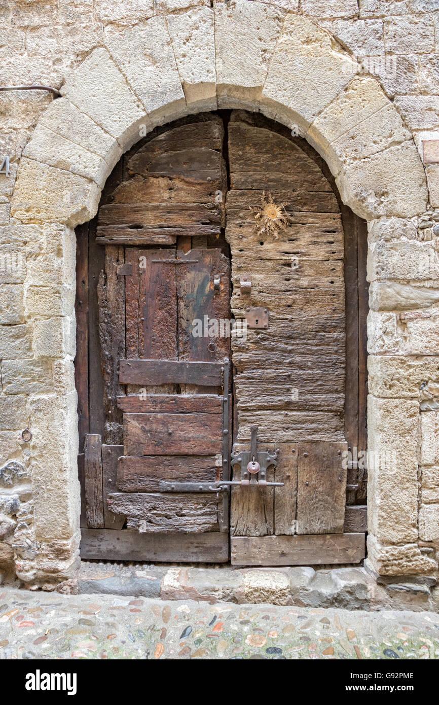 Antique wooden door in the medieval village of Besalu in Catalonia, Spain. - Antique Wooden Door In The Medieval Village Of Besalu In Catalonia