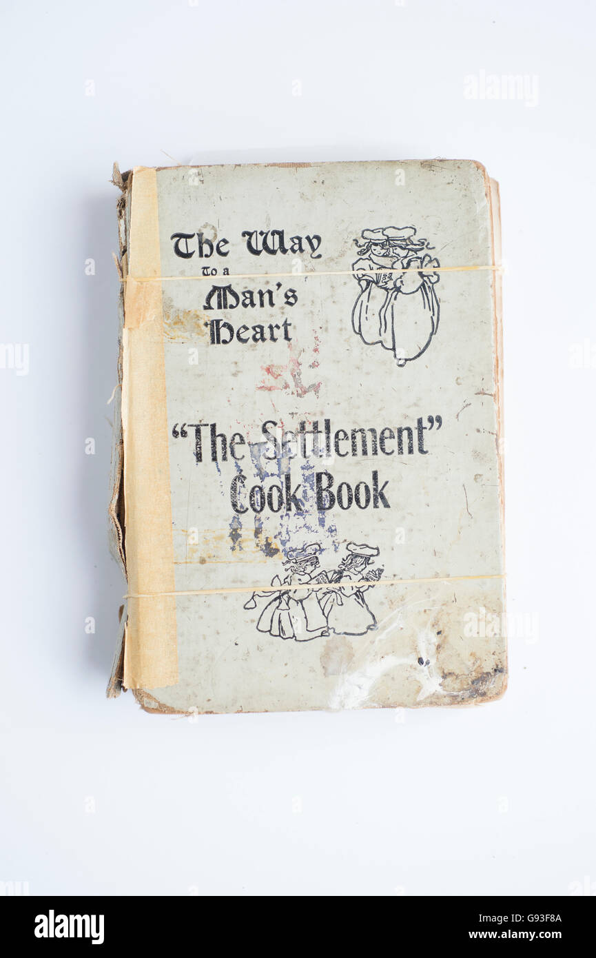 A battered copy of an old classic cookery book: 'The Way to a man's Heart: The Settlement Cook Book'. - Stock Image