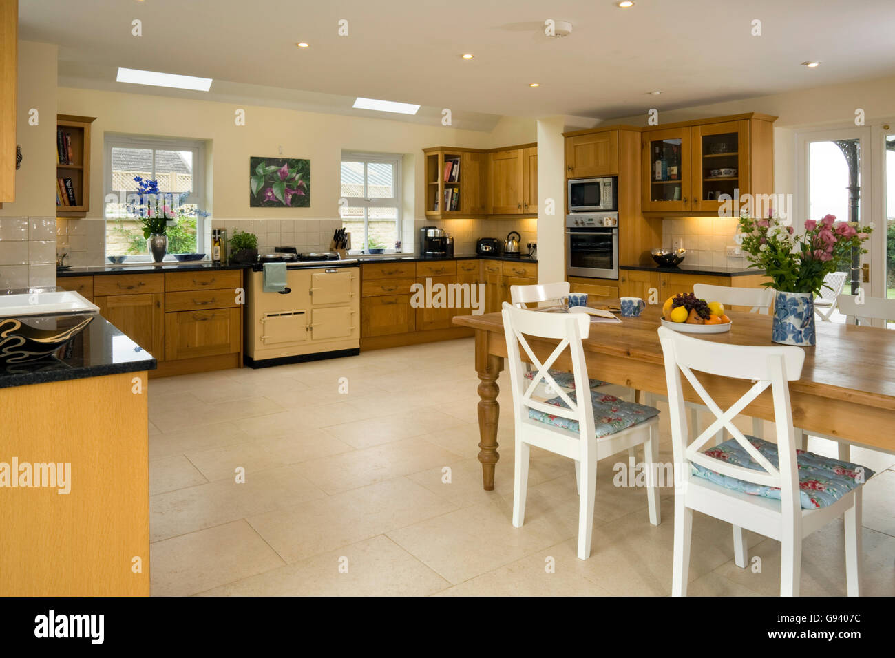 Uk A Large Contemporary Kitchen With An Aga And Dining Table And