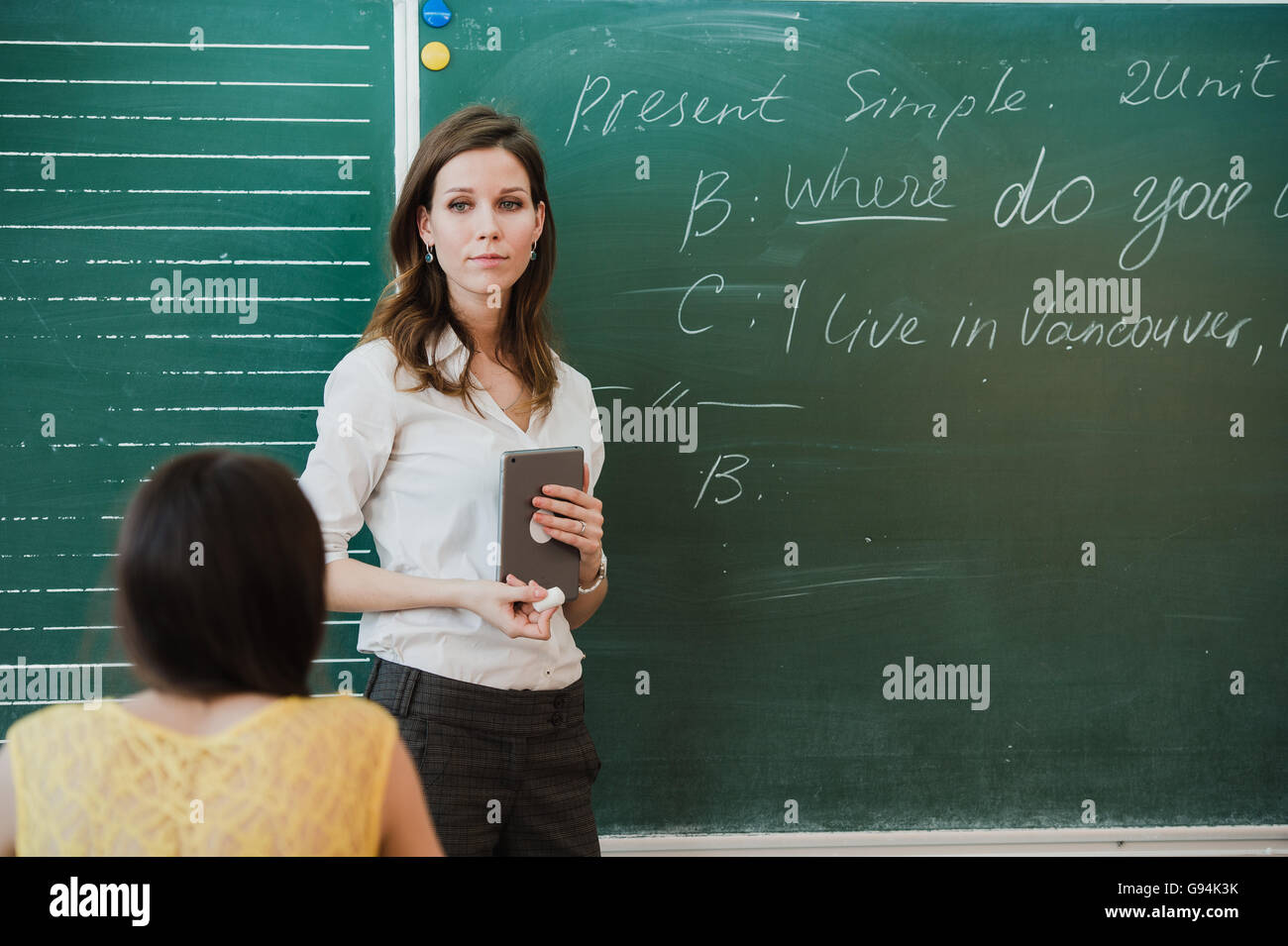 Young attractive female teacher of maths interacting with her young ...
