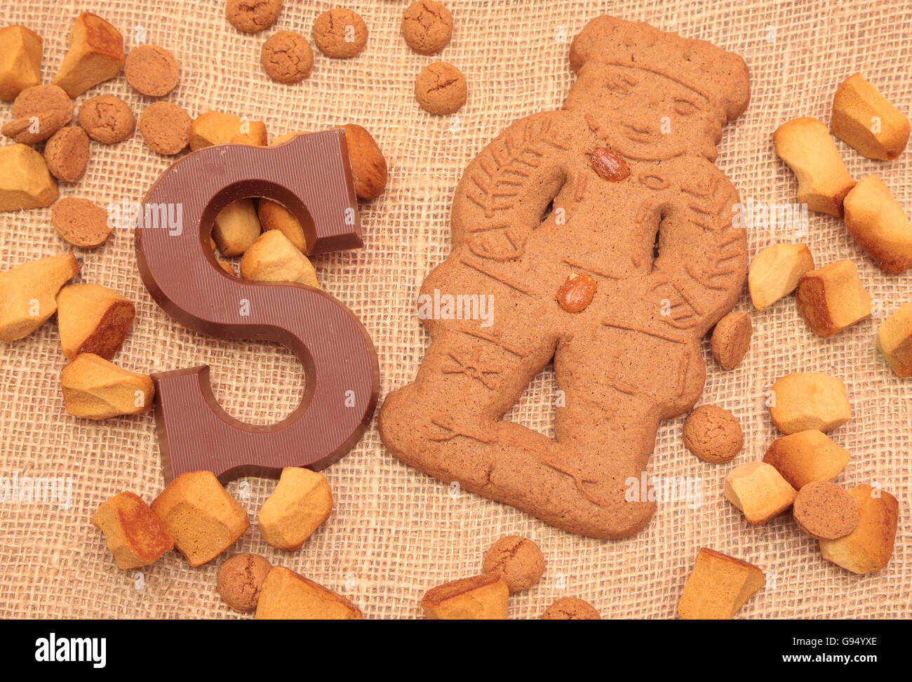 Traditional chocolate initial and gingerbread man for the celebration of Sinterklaas, a dutch holiday on december - Stock Image