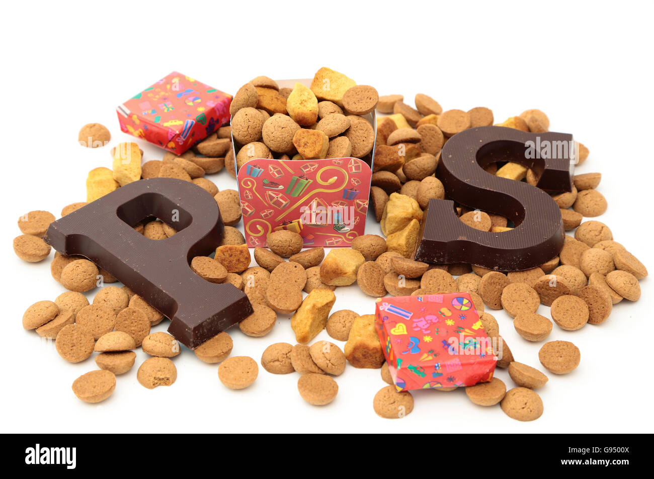 Traditional chocolate initials and cookies for the celebration of Sinterklaas, a dutch holiday on december the fifth - Stock Image