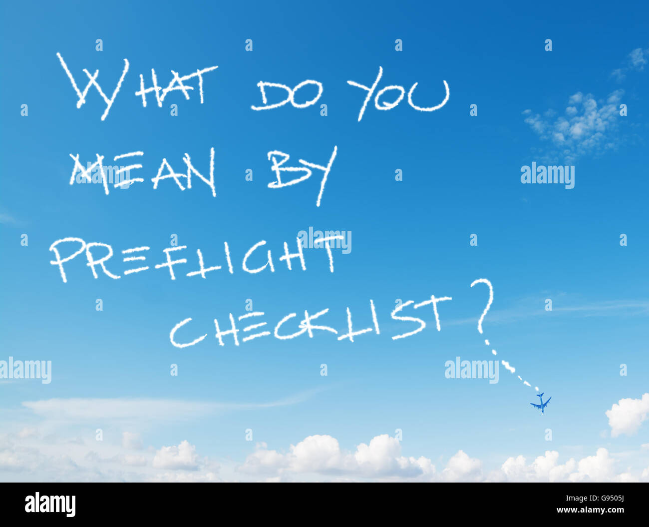 'what do you mean by preflight checklist?' written in the sky with contrails left by airplane - Stock Image