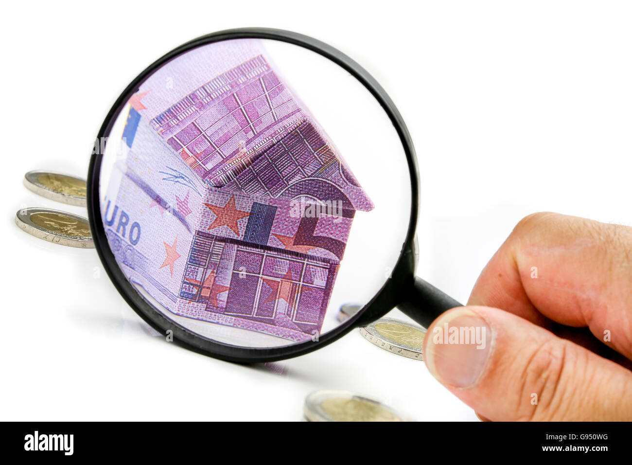 Real estate concept with Euro bill House and expenses under magnifying glass Stock Photo
