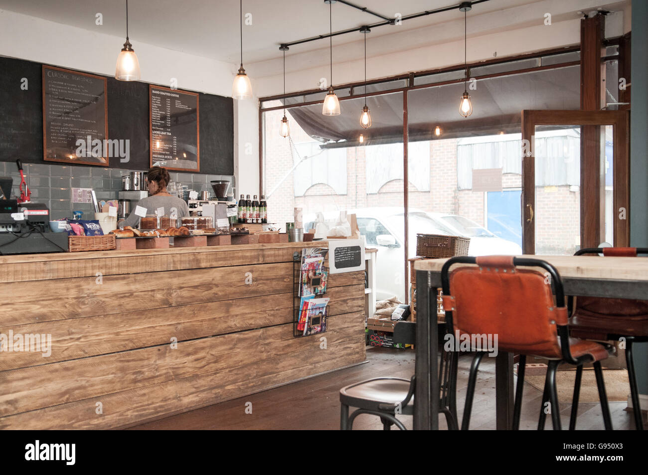 Picture of: Interior Of A Rustic Coffee Shop With A Large Wooden Table In Stock Photo Alamy