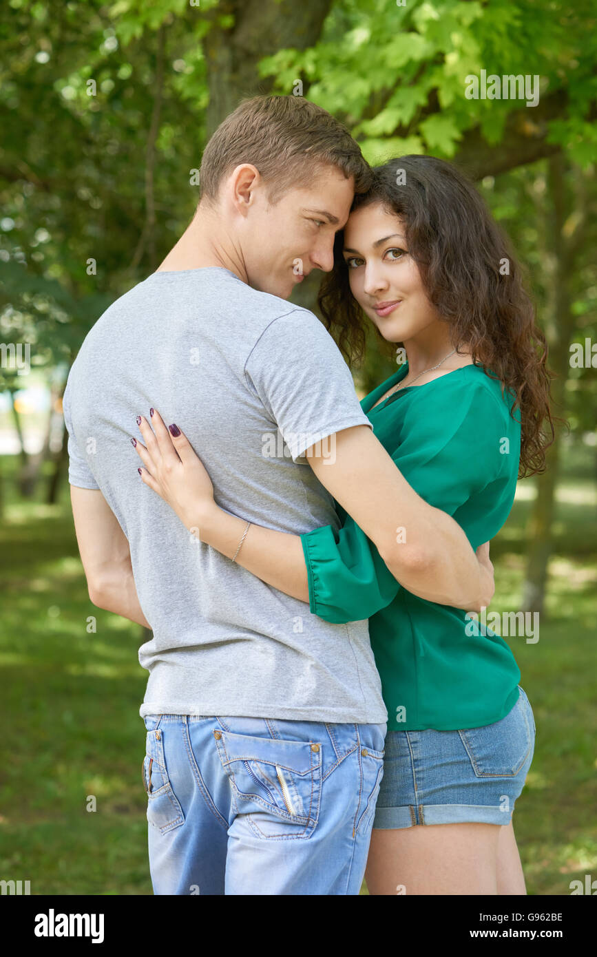 Romantic Couple Posing In City Park Summer Season Young People Backside