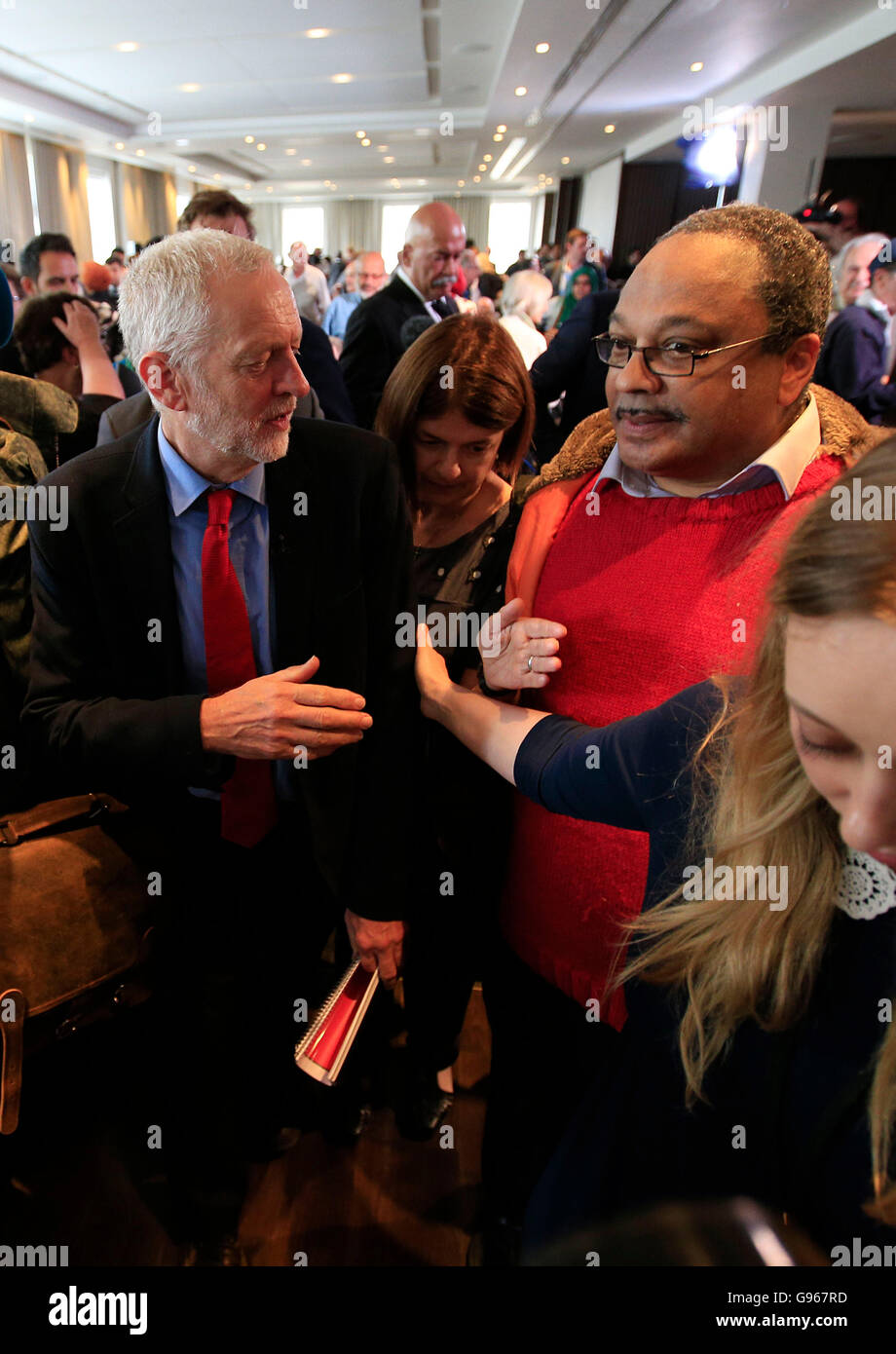 Labour Leader Jeremy Corbyn with Marc Wadsworth (right), who runs Momentum Black Connexions, following a speech - Stock Image