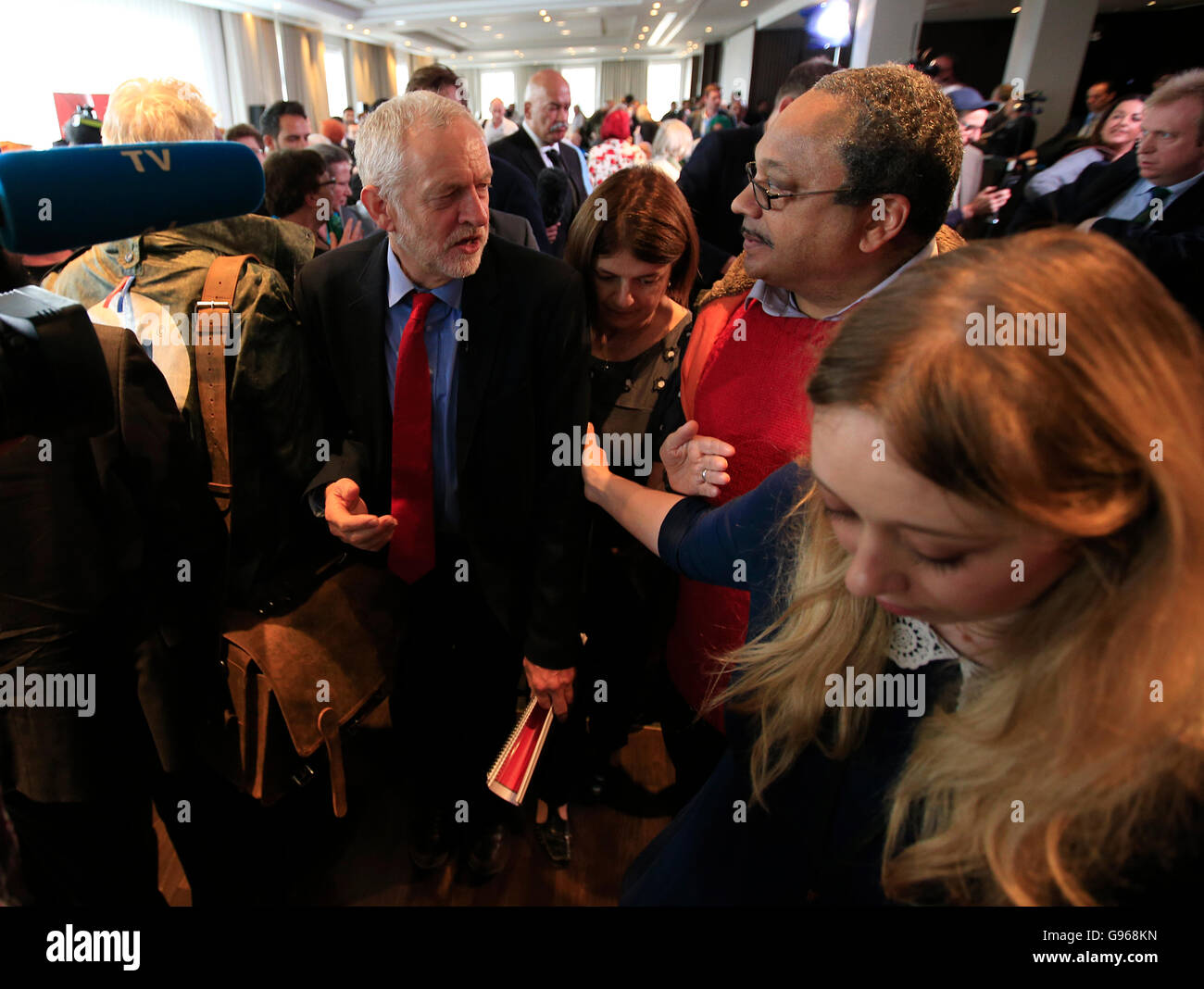 Labour Leader Jeremy Corbyn with Marc Wadsworth (centre), who runs Momentum Black Connexions, following a speech - Stock Image