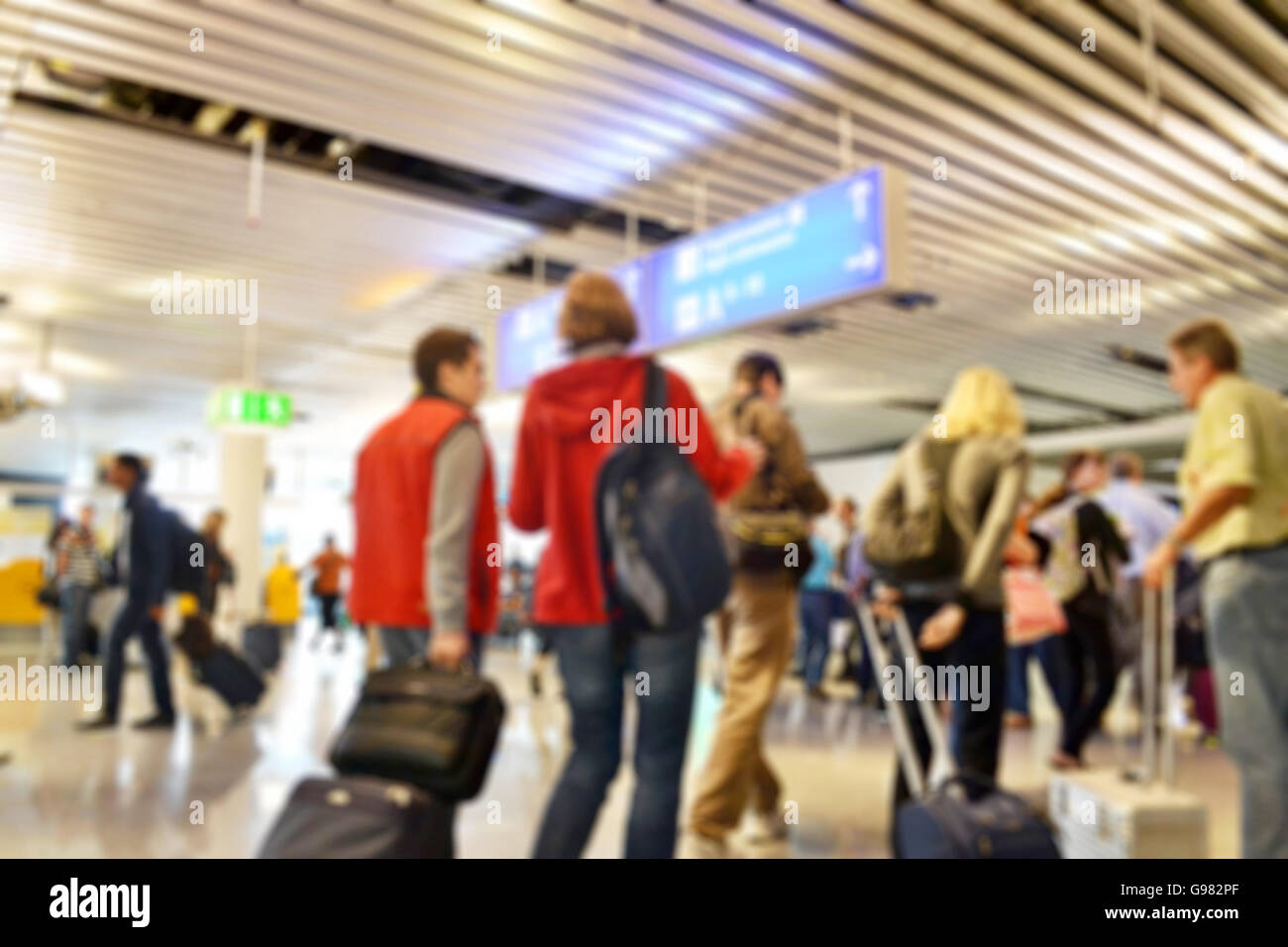 Blurred background of a very busy European international airport during the day - Stock Image