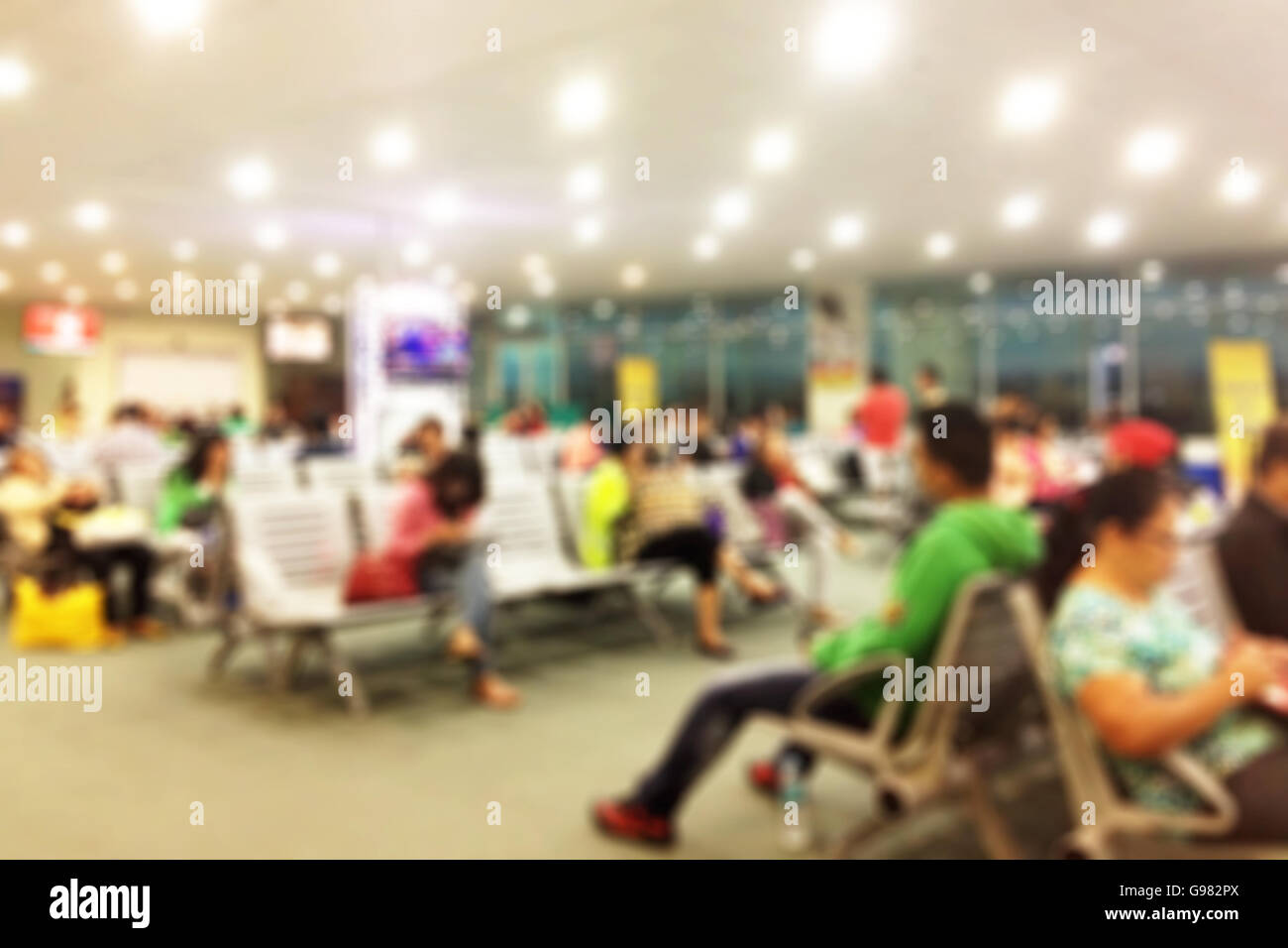 Blurred background of an airport terminal gate - Stock Image
