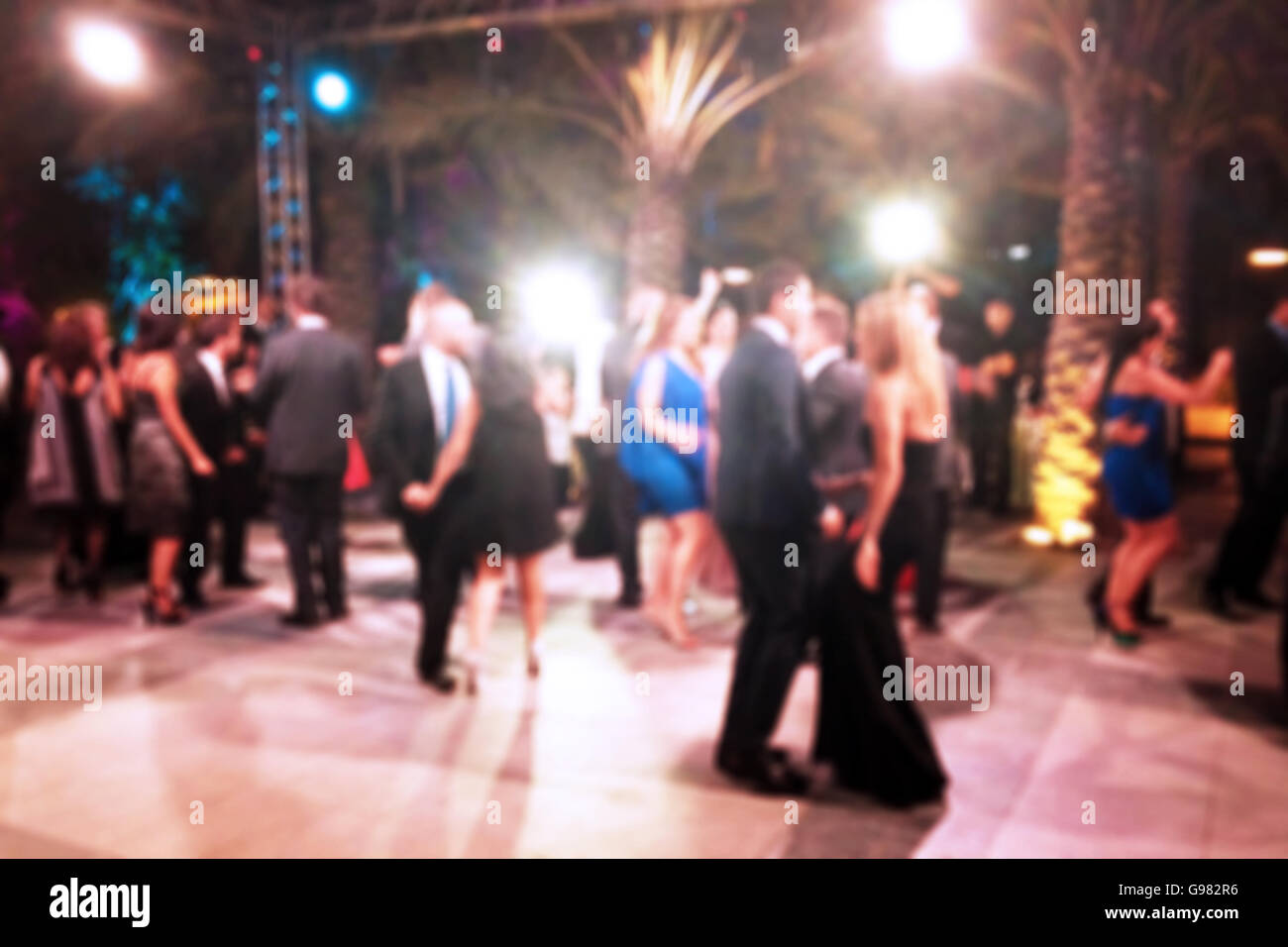 Blurred background of night dancing party outdoor - Stock Image