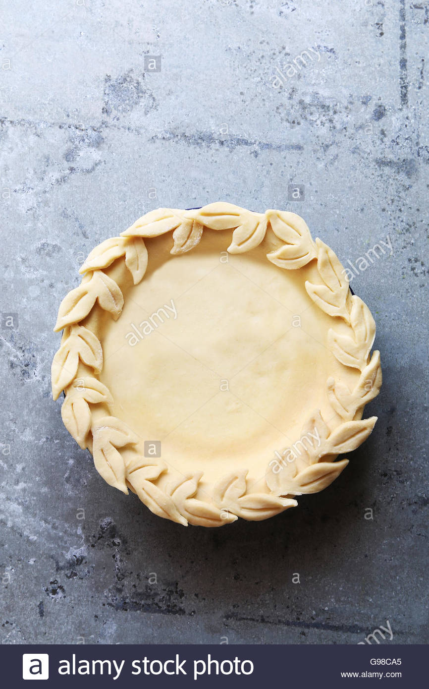 Uncooked pie crust with leaves decoration.Top view. - Stock Image
