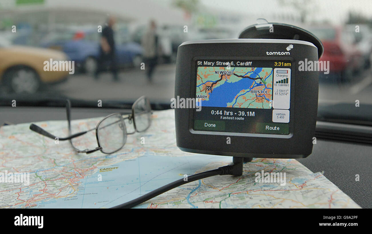A tomtom satellite navigation or sat nav system on the dashboard of a car showing the route from Bristol to Cardiff. - Stock Image