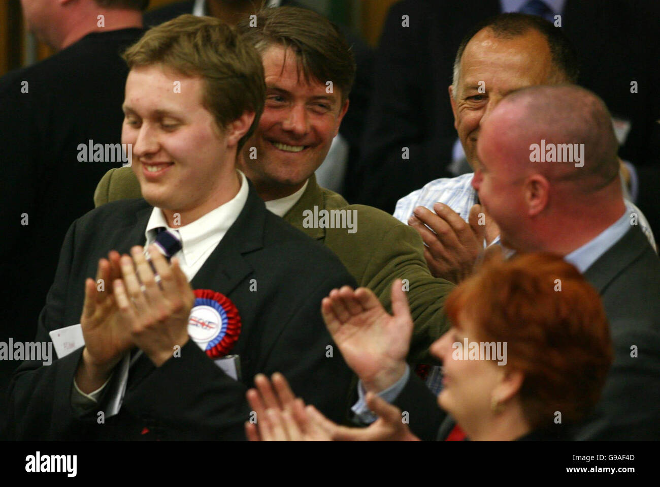 The British National Part's London organiser Richard Barnbrook (second from left) jokes with BNP candidates - Stock Image