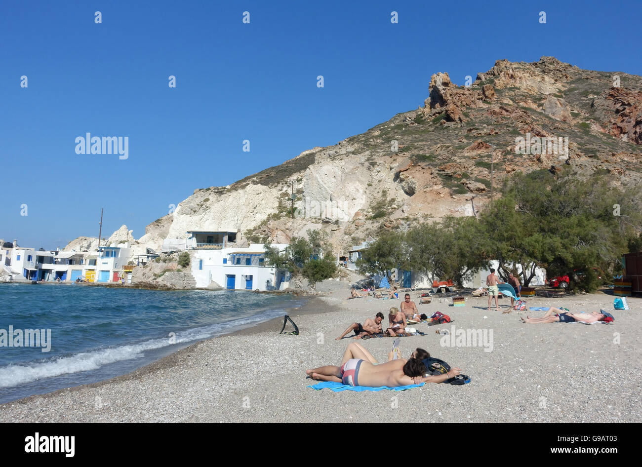 holidaymakers sunbathing on a beach in the Greek island of Milos - Stock Image