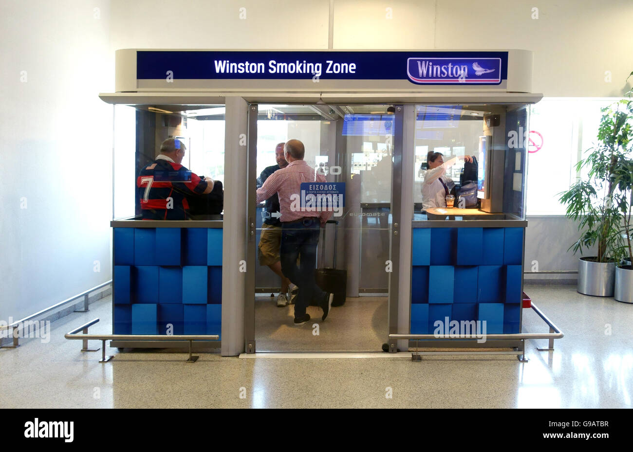 A smoking cubicle at Athens airport Greece - Stock Image