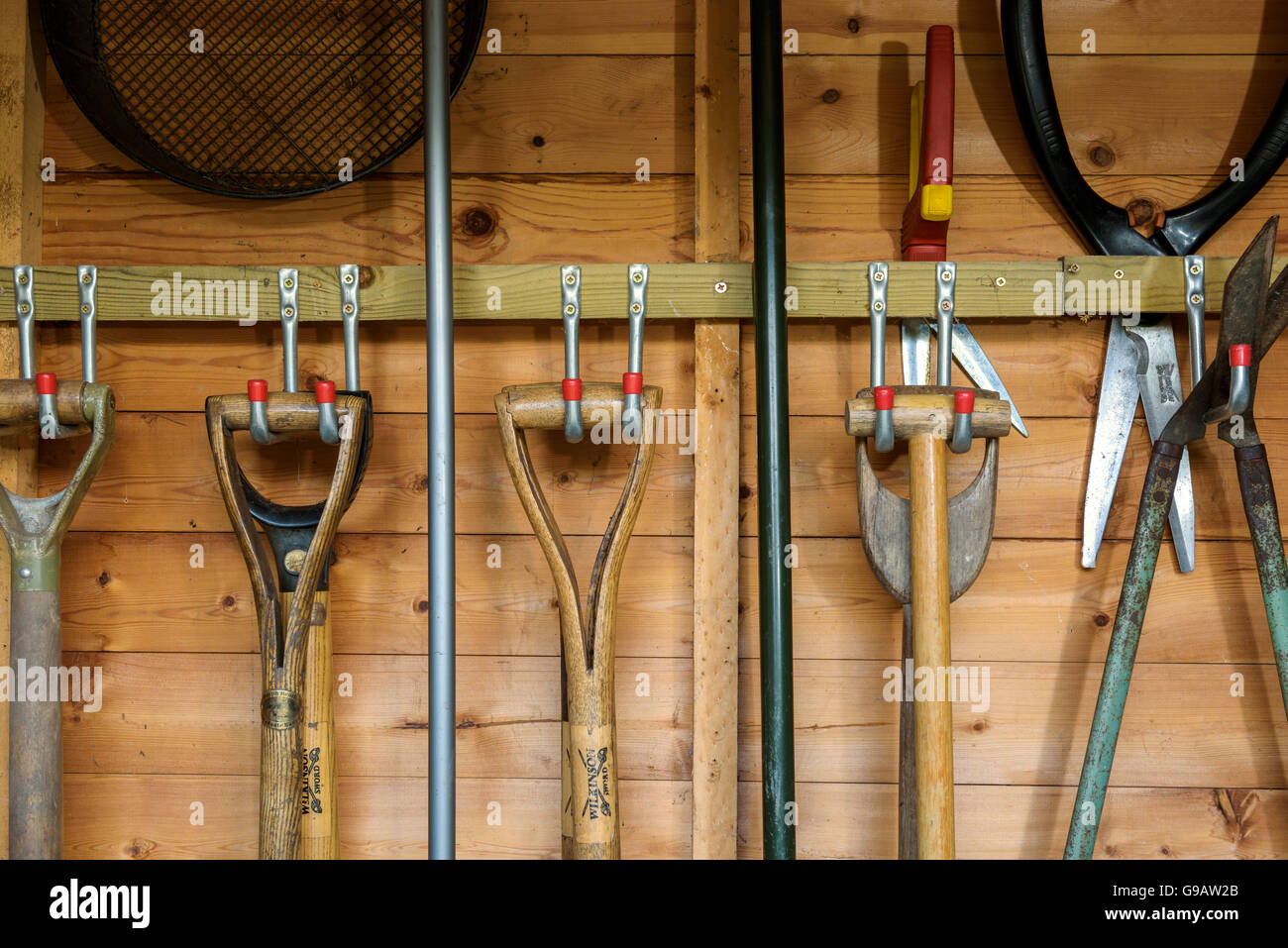 Bon Garden Tools Hanging In A Wooden Shed.   Stock Image