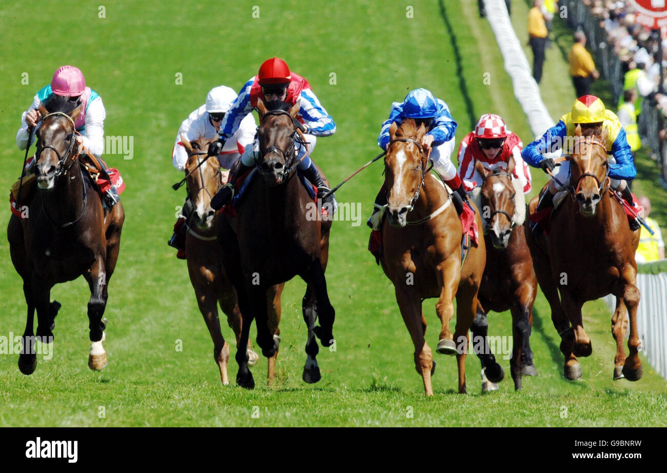 Racing Epsom 3.00 The Vodafone Diomed stakes fourth from left in the blue and white NAYYIR Jockey Frankie Dettori. - Stock Image