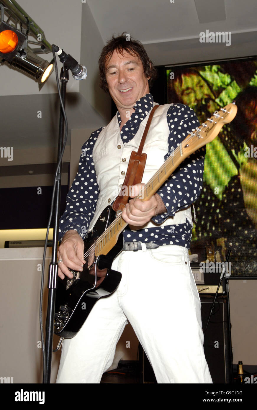 Steve Diggle of the Buzzcocks perform on stage during the MOJO Honours List launch - which comprises 10 awards, - Stock Image