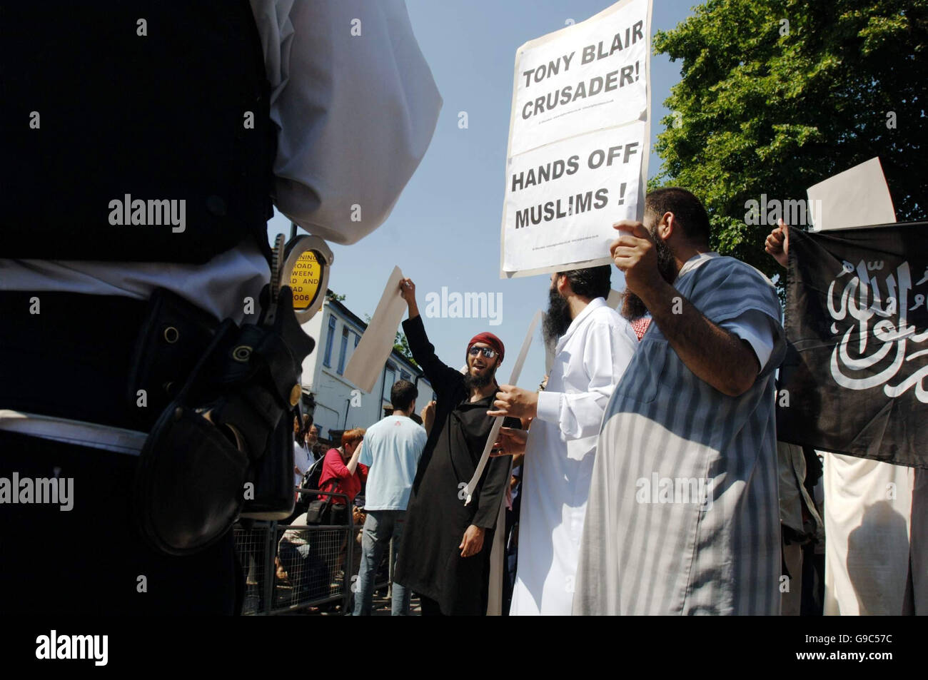 Muslim protestors outside Forest Gate police station in east London demonstrate against last Friday's anti-terror - Stock Image