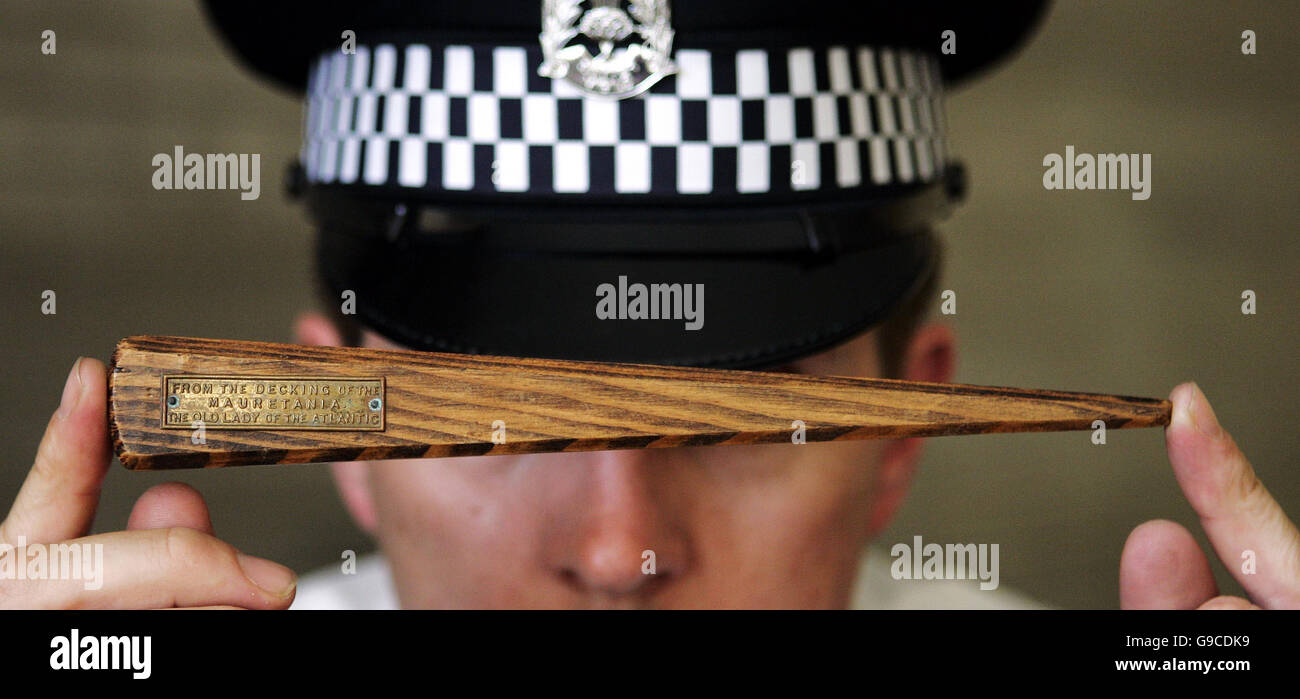 Lothian and Borders Police Constable Stephen McGill from the Safer Communities Department holds a letter opener - Stock Image