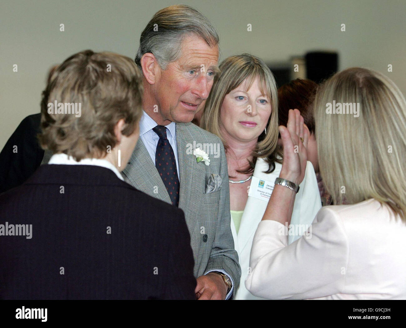 The Prince of Wales speaks with local residents who were caught up in the Buncefield oil depot fire last year, during - Stock Image