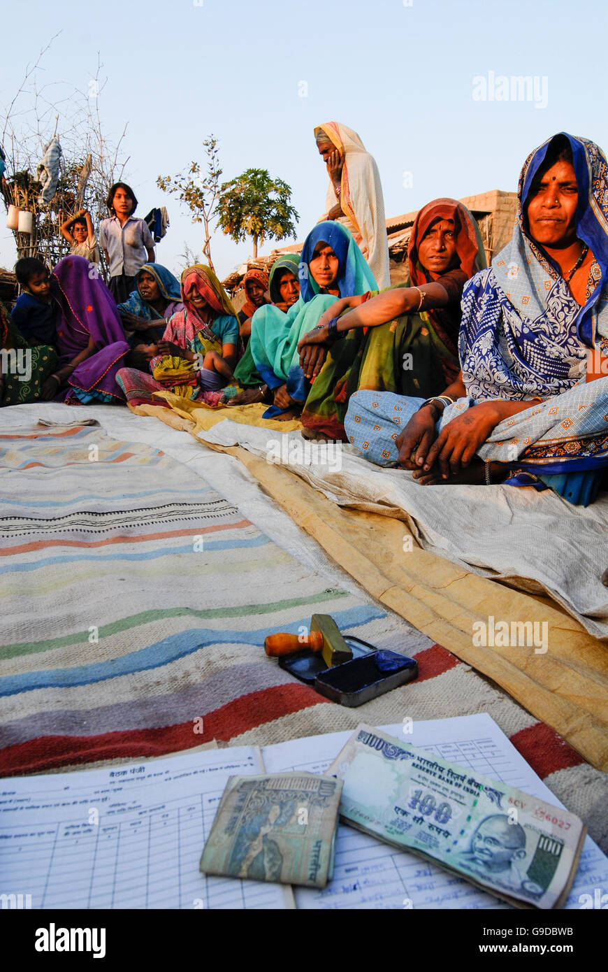 INDIA, Madhya Pradesh , microcredit, rural woman saving bank in village, illiterate uneducated women sign with thumb Stock Photo
