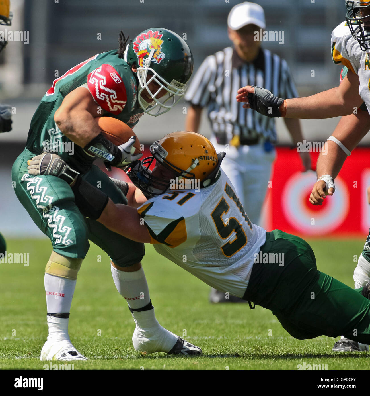 Jonathan Barrera, #23 Mexico, is tackled by Layke Rossiello, #51 Australia, at the Football World Championship on - Stock Image