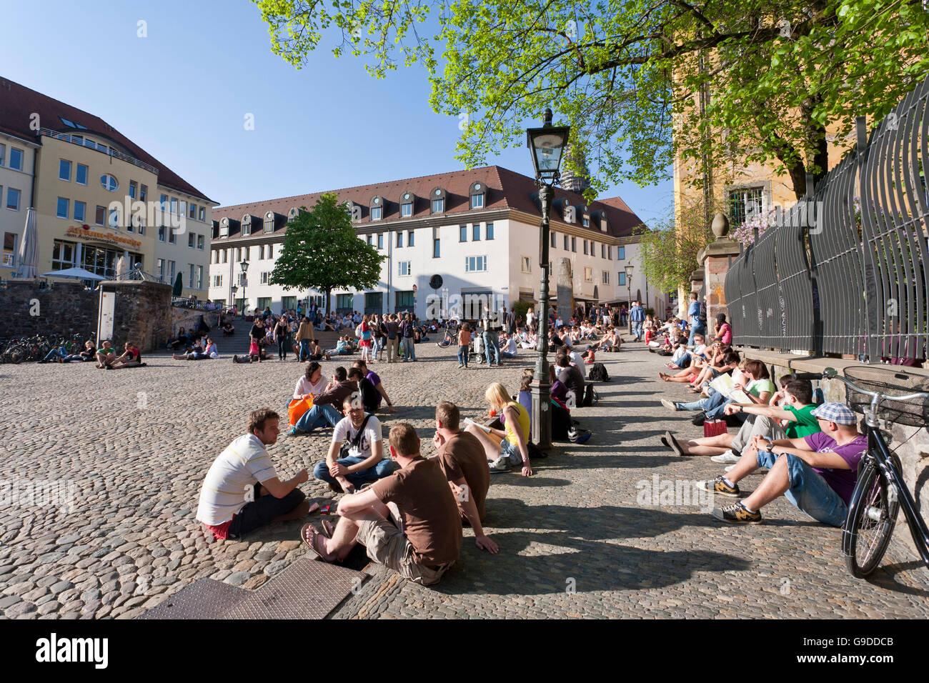 Augustinerplatz square, students, student life, Freiburg im Breisgau, Black Forest, Baden-Wuerttemberg - Stock Image