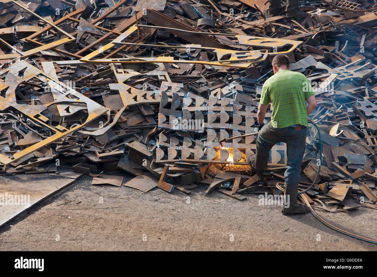 Welder cutting apart scrap metal, port, Stuttgart, Baden-Wuerttemberg - Stock Image