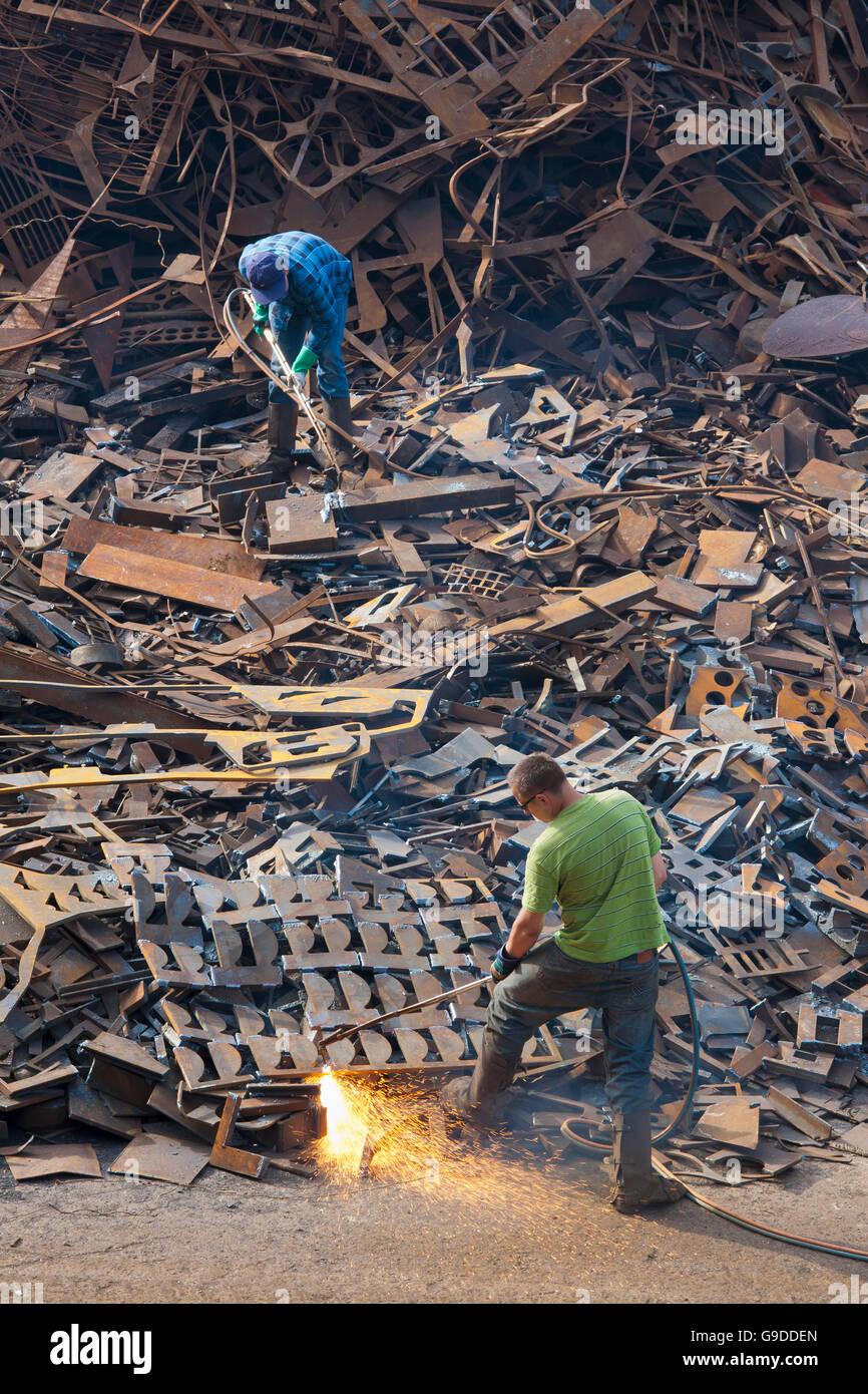 Welders cutting apart scrap metal, port, Stuttgart, Baden-Wuerttemberg - Stock Image