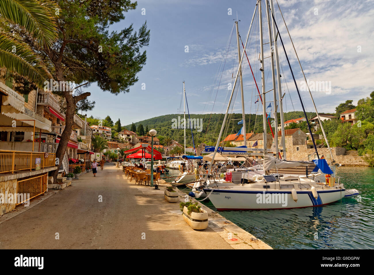 Boats berthed at the village quay of Stomorska on the island of Solta in Croatia. - Stock Image