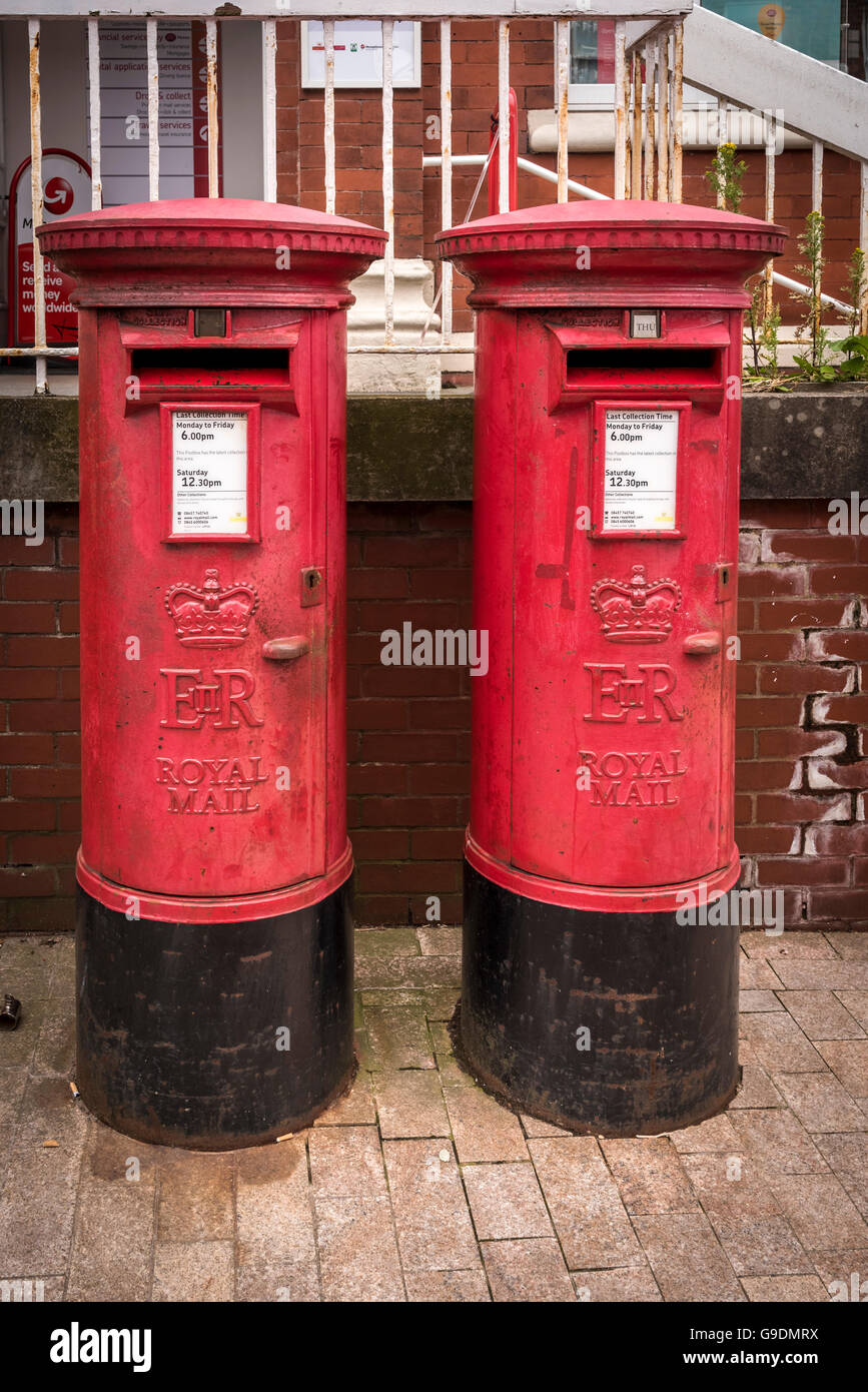 A pair of English red pillar boxes post boxes postboxes. postbox - Stock Image