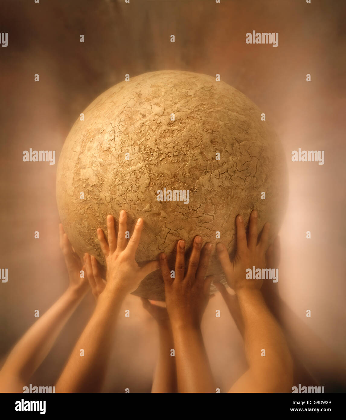 Human hands holding up a round-shaped structure showing teamwork - Stock Image
