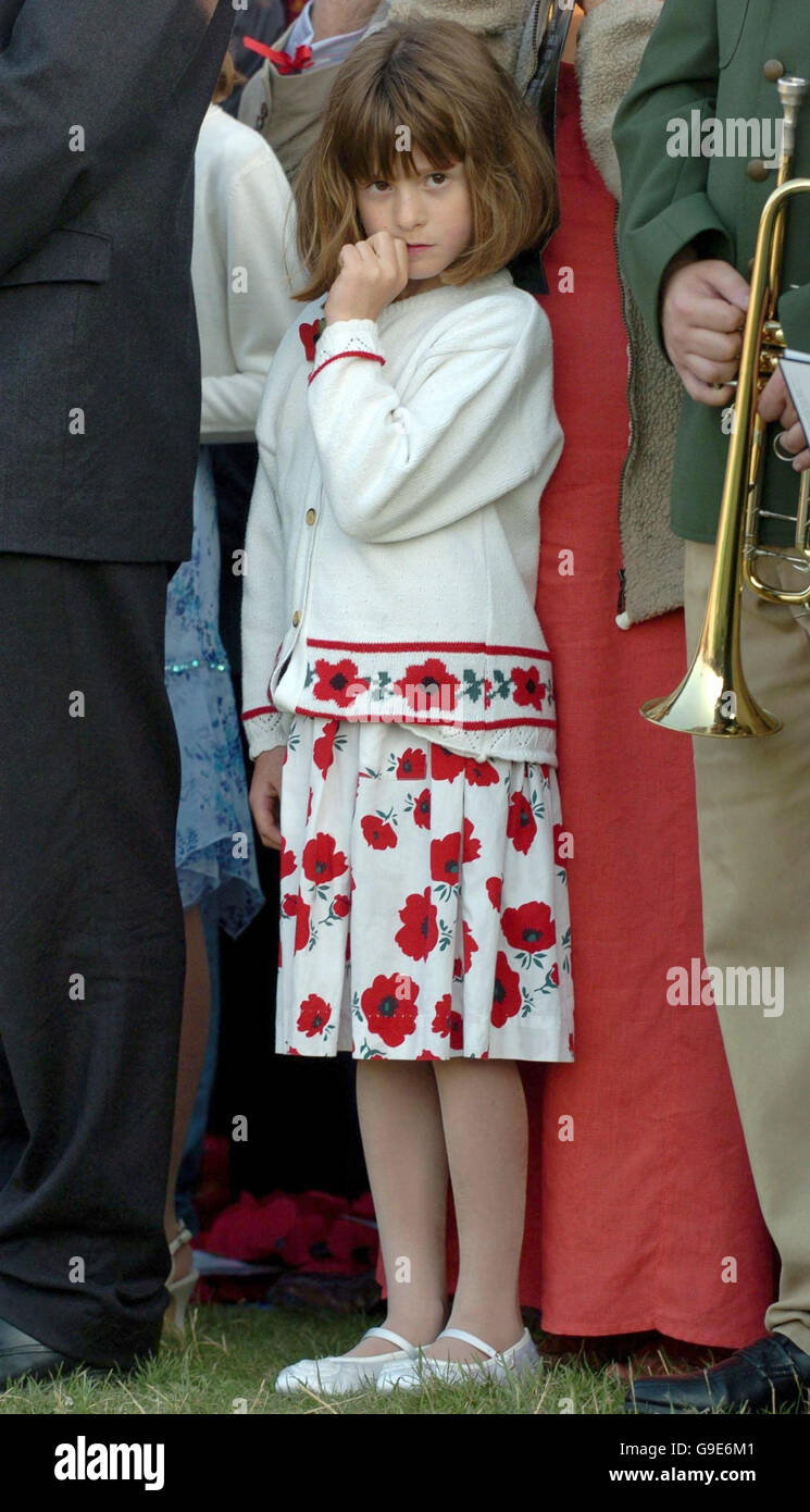 Somme Memorial 90 Years : A young girl wears a poppy dress at the Battle of the Somme memorial service in Lochnagar - Stock Image