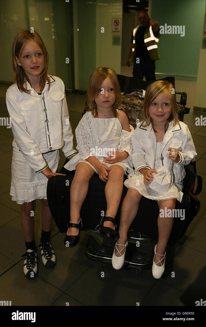 Irish children (left to right) Clara, Shauna and Emily Murphy arrive home to Dublin airport after they were evacuated - Stock Image