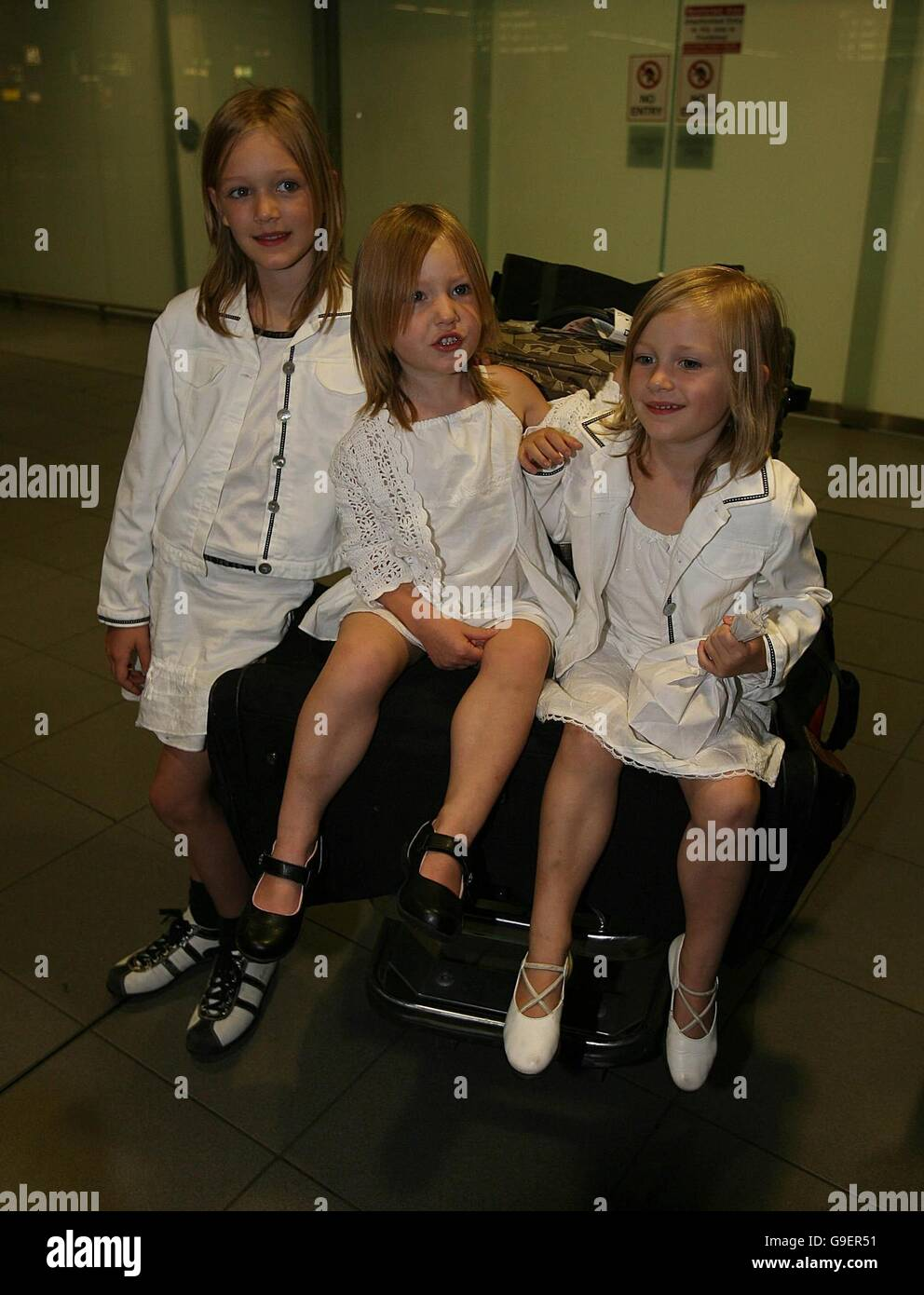Irish children (left to right) Clara, Shauna and Emily Murphy arrive home to Dublin airport after they were evacuated Stock Photo
