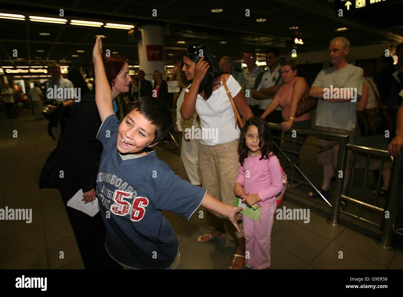 Irish people welcome their relatives home to Dublin airport after they were evacuated from Lebanon by the Irish - Stock Image